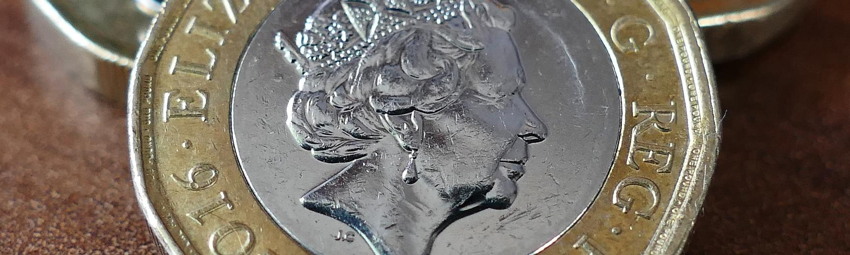 Close up photograph of a pile of shiny pound coins